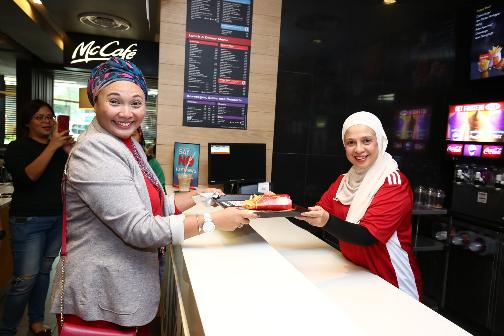 Chief Marketing Officer of McDonald's Malaysia, Melati Abdul Hai handing over an order to a happy customer