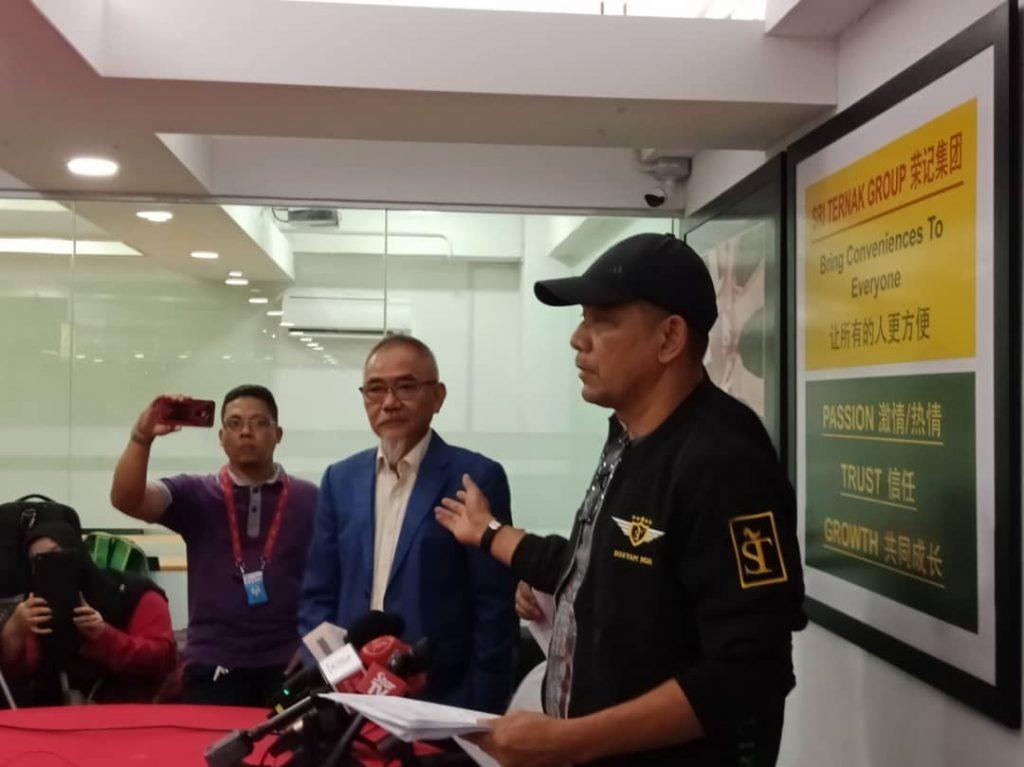 Datuk Raymond dan En. Ho Ah Chai membuat laporan polis